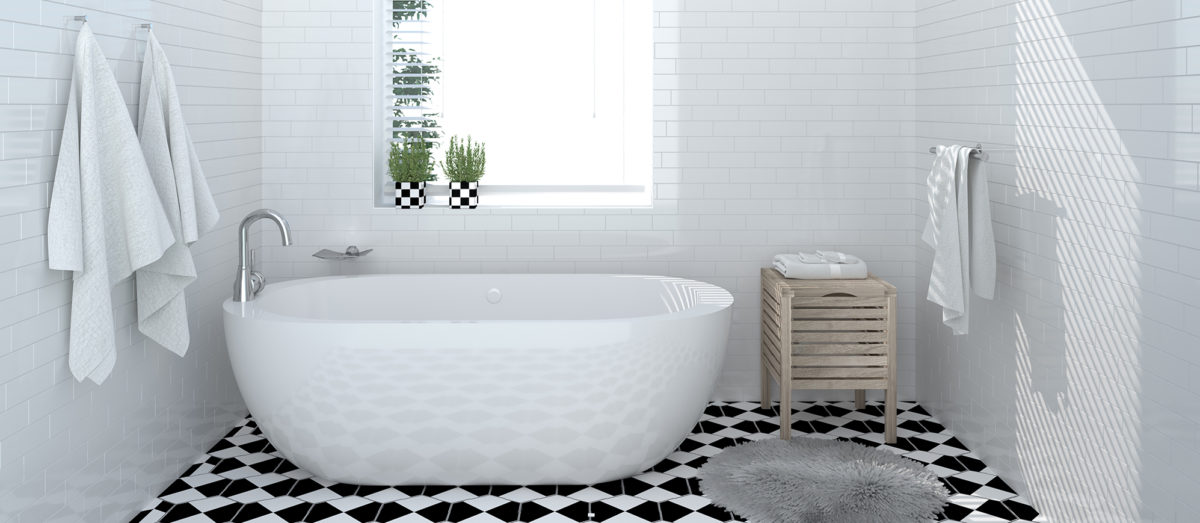 standing bath tub on tile floor