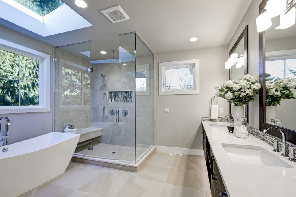 modern bathroom with skylight and lighting fixtures